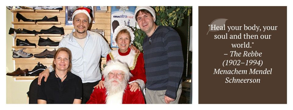 "staff members with Santa | ""Heal your body, your soul and then our world."" – The Rebbe (1902–1994) Menachem Mendel Schneerson"