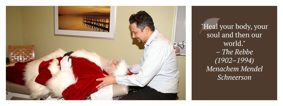 "Dr. Renzoni examining santa | ""Heal your body, your soul and then our world."" – The Rebbe (1902–1994) Menachem Mendel Schneerson"